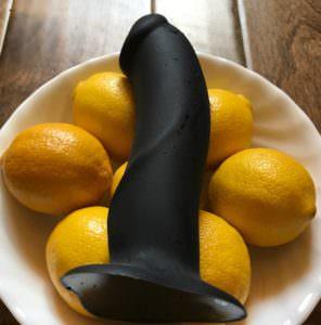 Fun Factory Boss dildo black on bowl of lemons