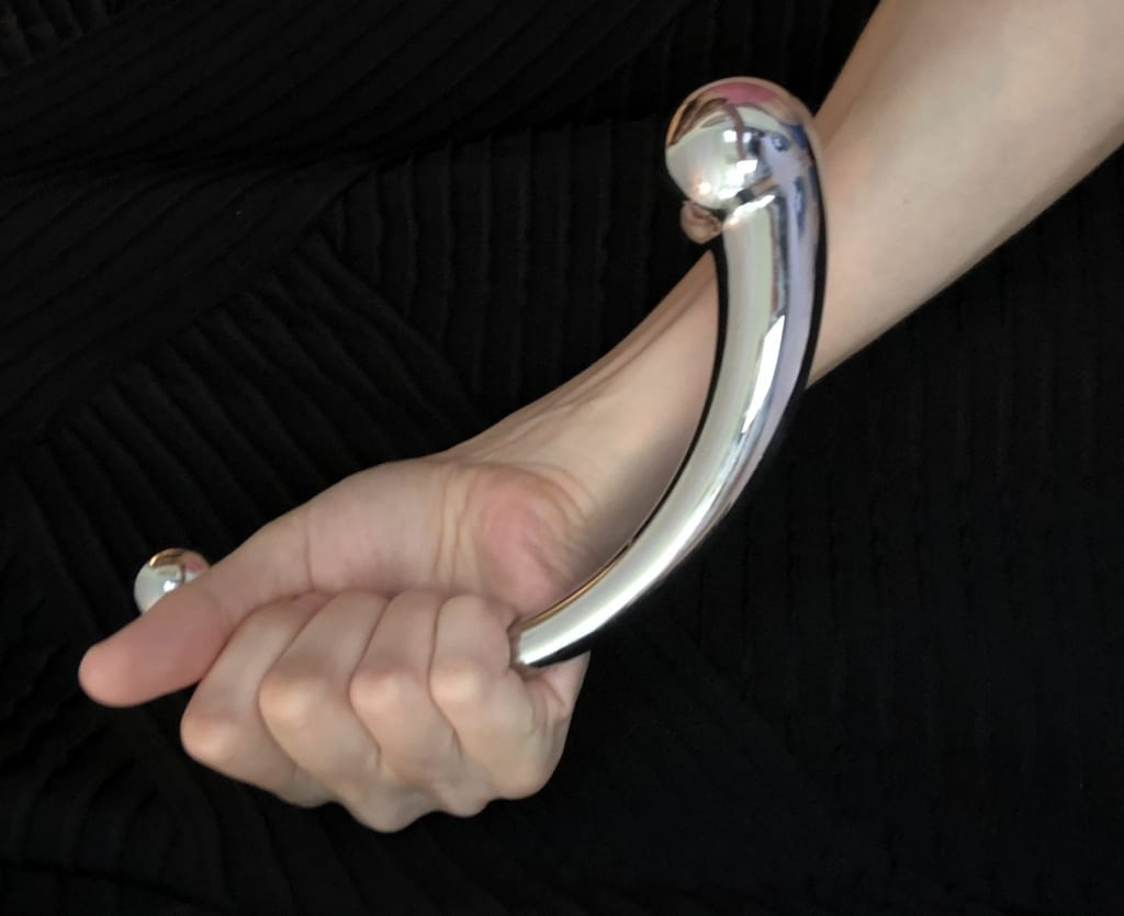 Njoy Pure Wand Stainless Steel Dildo in hand