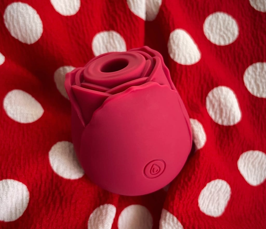 NS Inya Rose vibrator for clitoral suction review, red polka dot background