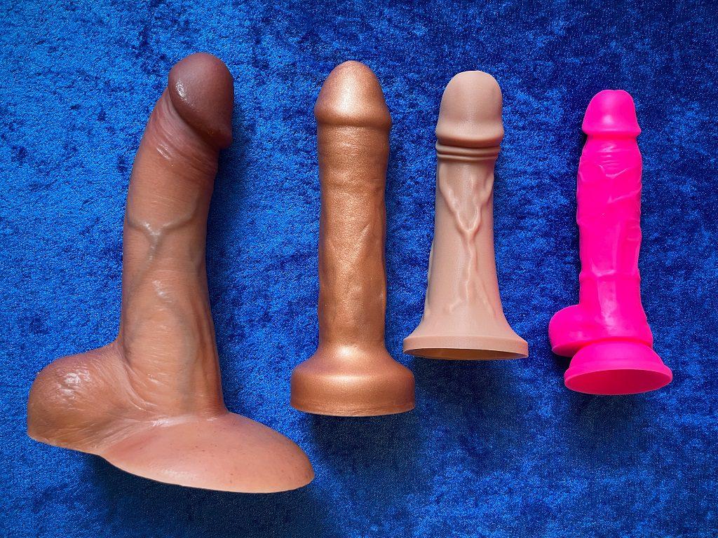 Triple density silicone dildos_ RealCock 2 Dirk, Uberrime Bella Triple, Pleasure Tailor Triarx, vs. average size dual-density Neo Elite 7.5 dildo